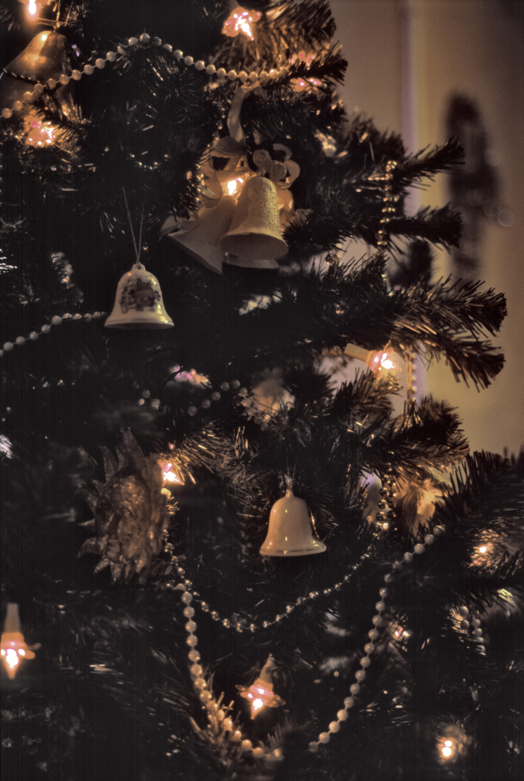 a traditionally decorated christmas tree with beads and ceramic hanging bells