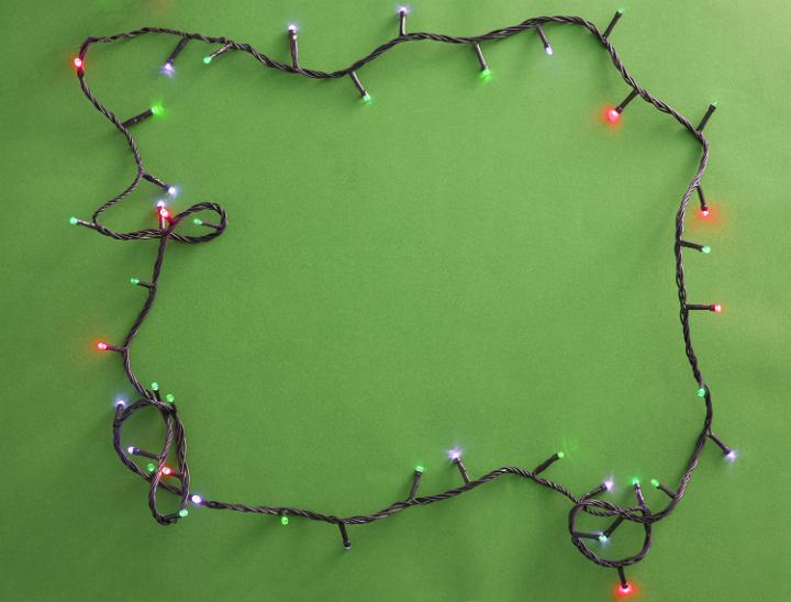 photo of festive garland on green background