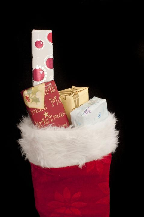 photo of small christmas gifts filling a red stocking