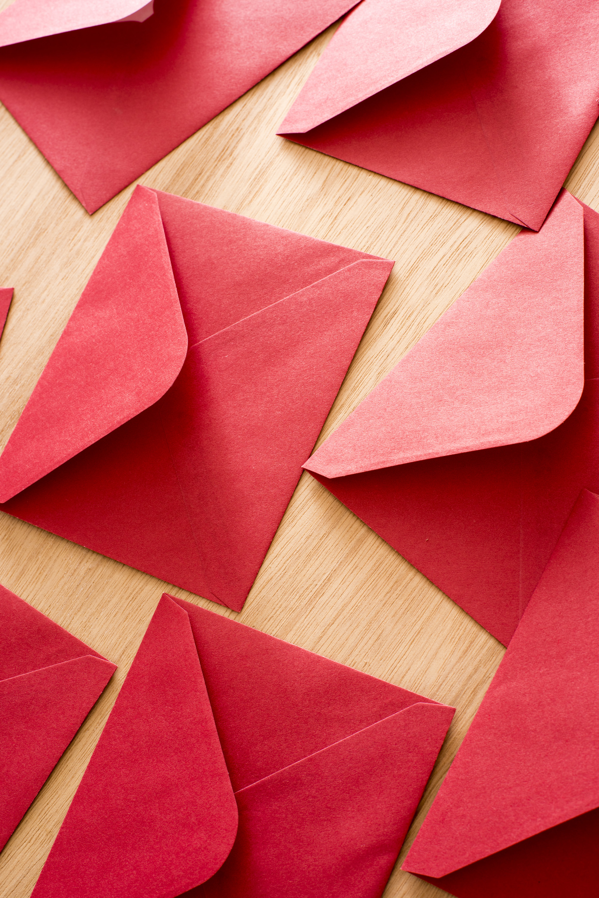photo of festive red christmas or valentines envelopes