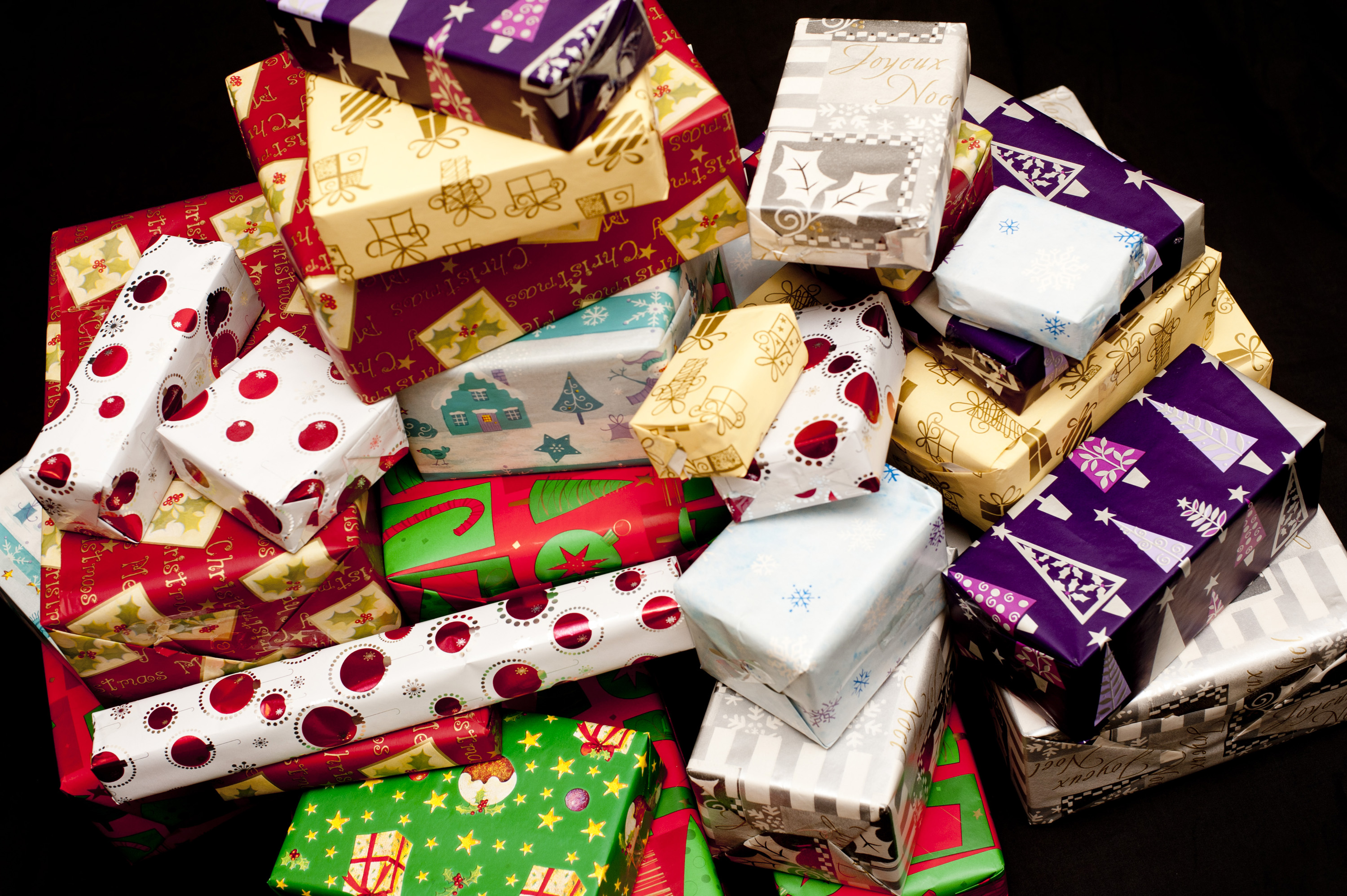 christmas gifts gift pile wrapped colorful paper colored sizes patterned christmasstockimages assorted brightly shapes