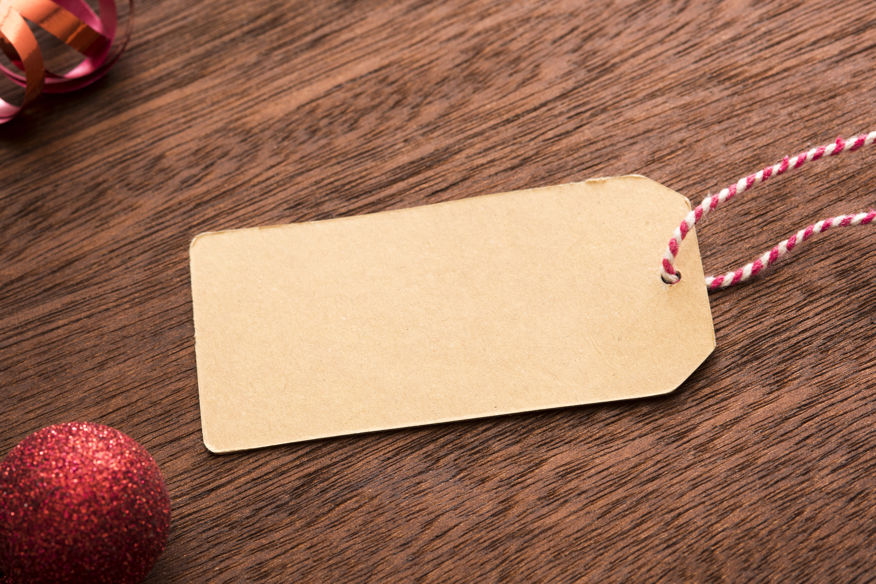 photo of blank gift tag with xmas decorations