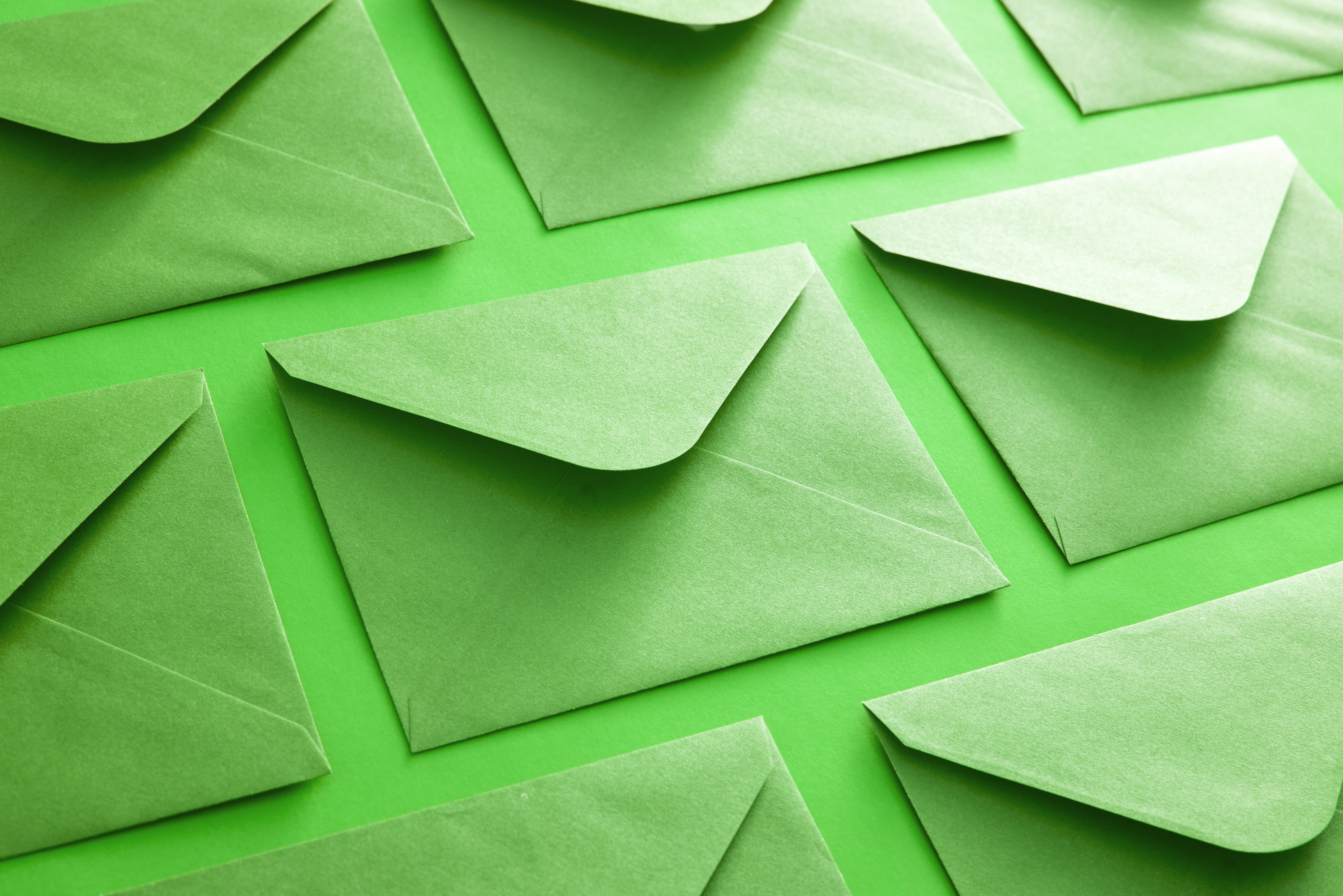 photo of colorful green envelope background