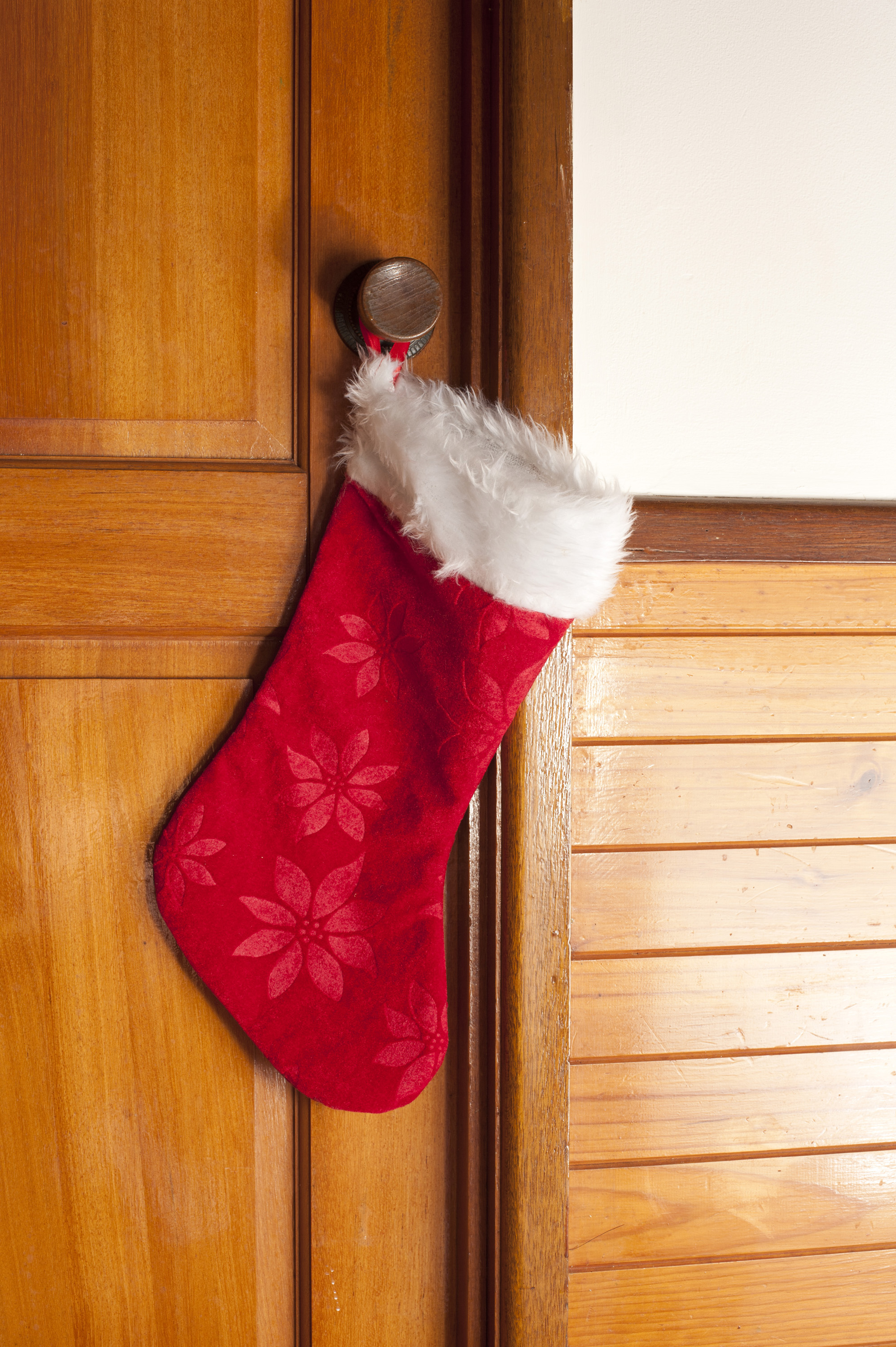 Photo Of Empty Red Christmas Stocking Hanging On A Door